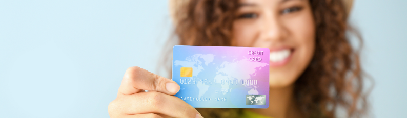 smiling girl holding payment card