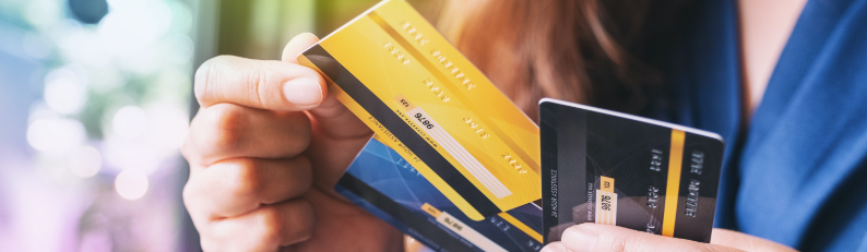 hands holding credit cards